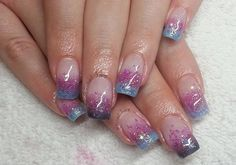 Blue and violet glitter polish arranged as Ombre French tips. Be creative with your Ombre nails and transform them into pretty glittering French tips.