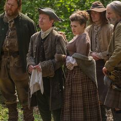 Ned Gowan, his 'guest,' and the other wedding attendees.