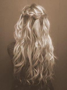 loose waterfall braid with wavy hair