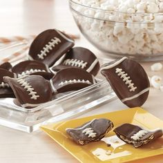 Candy Dipped Football Potato Crisps - Salty meets sweet in this super playoff of flavors. Decorated like footballs, these delicious Candy Melt candy dipped chips or crisps will be a hit at your next party, so make a bowl full because no one will be able to each just one.