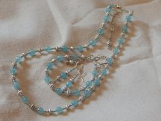 Light turquoise aqua blue and silver necklace bracelet and earrings set $40.00