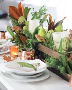 DIY: A Transitional Tablescape by Joanna Gaines. For an easy transition from Thanksgiving to Christmas, simply remove the artichokes, pears and dried oak leaves and replace with pomegranates and artificial berries. See Christmas Tablescape board for pic.