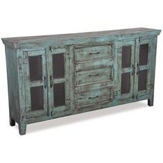 This vintage sideboard by Shivam International brings a reclaimed feel from antique inspirations. Hand rubbed, distressed blue painted finish adds a splash of color and style to any room in the home. Get the look at afw.com.
