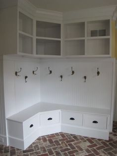 mudroom pantry storage - particularly fond of the brick floor