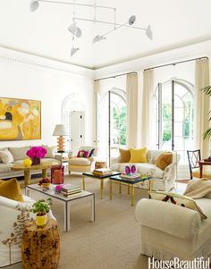 Sophisticated and Colorful  Bursts of sunny yellow and fuchsia refresh traditional architecture in the living room of this Naples, Florida...