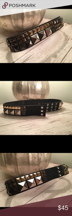 Bcbgmaxazria leather black studded belt Bcbgmaxazria leather black studded belt. WORN but in good shape. Has some marks on the inside of belt. Statement belt with gold, gunmetal bronze and silve studs. BCBGMaxAzria Accessories Belts