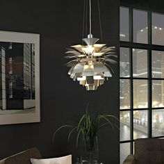 """Bring a touch of elegance to your space with the Petal Silver Pendant Chandelier. This hanging aluminum lamp has dozens of """"petals"""" that create a stunning visual look. Height adjusts and hangs from the ceiling using three 42"""" long aluminum adjustable cords.  #home #homefurniture #DCGstores"""