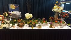 """Natural centerpieces created by """"WOW"""" Event Design & Coordination--many different ways to do it whether with birch vases, natural sticks or greenery! Vase rentals also available!"""