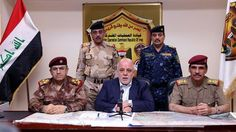 Iraqi Prime Minister Haider al-Abadi (C) delivers a brief speech on state TV after the liberation of Fallujah from the Daesh terrorist group, on 17 June, 2016.