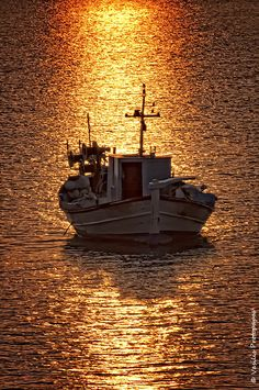 The golden path -A fishing boat at sunset time in the small port of Diapori - Lemnos Island - Greece Wonderful Places, Beautiful Places, Myconos, Water Crafts, Greek Islands, Fishing Boats, Ciel, Belle Photo, Wonders Of The World