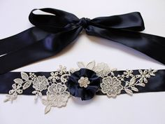 Custom Color (Navy Blue) Lace Flower Bridal Sash Belt w/ Silver Lace & Flower Rhinestone, Wedding Sash, Crystal Sash, Wedding Dress Sash. $70.00, via Etsy.