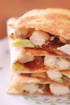 Cheesy chicken, bacon, and avocado quesdillas.