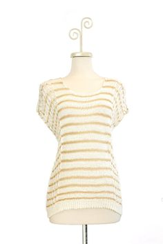 Dressing Your Truth - Type 1 Creme Brulee Sweater - This bright ivory colored sweater features gold threads and a fun loose weave. Pair with your favorite bright colors for a Type 1 terrific look. 58% Acrylic, 42% Nylon Cap Sleeve Scoop Neck 22 inches in length from top of shoulder to hem (measurement taken from size small)