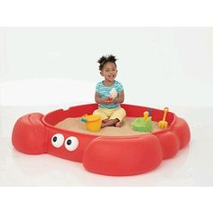 Lobster Sandbox.  This is great and unique idea for children who are toddlers. They would love to play in the sandbox which has this shape. It would be good to have one or two more children here so that children develop social skills along with other skills.