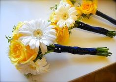 white+and+yellow+bridesmaid+bouquets  Something like this, with blue ribbon that matches dresses wrapped around