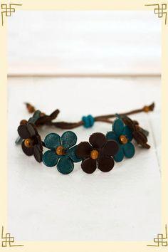 leather bracelet (go through flower center, then bead, back through flower then wrap onto leather)