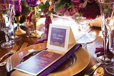Purple and gold tablescape including gold charger.  Would add gold napkin ring and dark purple tablecloth