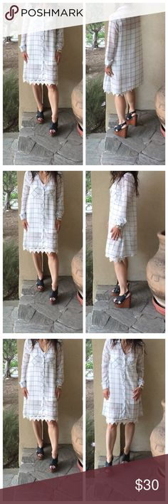 Chiffon checkered tunic Pretty chiffon long sleeves loose fit trapeze style black and white checkered dress ( modeled with lace extender that's sold separately in my boutique) PLEASE USE Poshmark new option you can purchase and it will give you the option to pick the size you want ( all sizes are available) BUNDLE And SAVE 10% ( sizes updated daily ) Dresses