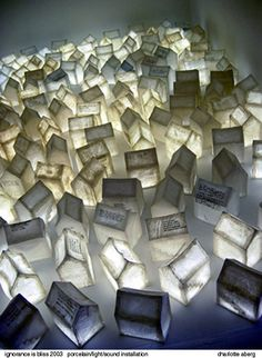 Ignorance Is Bliss 2003 by Charlotte Aberg installation porcelain/light/sound.
