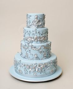 Pale blue wedding cake with embroidered detail
