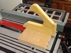 Slick Push Stick by markfitz - Here is a great push stick that I made to use on my table saw. I love this thing because I can apply a lot of downward pressure on the workpiece, which is hard to do with a straight stick. I used 1.75
