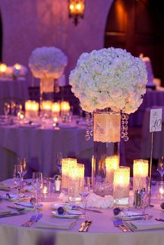 Wedding reception... I love the high flowers and the clear vase, so that when you are sitting, you can still see everyone at the table (make sure they are high enough!)