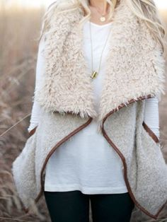 Warm vest in soft beige tones. Cozy top features contrasting faux leather trim, dramatic open front and side pockets. Super soft and perfectly paired with your favorite thermal and boots. Imported. ac