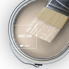 Behr color Adobe Sand is that essential joyous, relaxing vibe of cool sand between the toes in early summer, which is why we've chosen it as the Color of the Month. Adobe Sand serves as the perfect … Behr Paint Colors, Interior Paint Colors, Paint Colors For Home, Wall Colors, House Colors, Western Paint Colors, Home Depot Colors, Pastel Paint Colors, Organization Ideas
