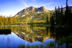 Sunrise reflection on Horseshoe Lake in the Lakes Basin of Eastern Oregon's Wallowa Mountain Range.