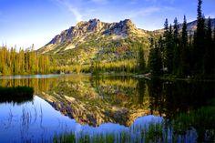 Sunrise reflection on Horseshoe Lake in the Lakes Basin of Eastern Oregon's Wallowa Mountain Range.