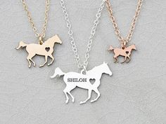 SALE • Racing Horse Necklace • Personalized Horse Lover Gift • Silver Horse • Barrel Racing • Horse Racing • Rodeo • Equestrian Gift Ideas Horse necklace in 935 Sterling Silver, 14K Gold Filled, or 14K Rose Gold Filled - great gift for someone with a love for horses by IvyByDesign on Etsy. Super cute horse - personalize it with engraved name or date, too! Another Version: https://www.etsy.com/listing/254029908 Model is wearing the Sterling Silver 18 inch option, with 1 ...