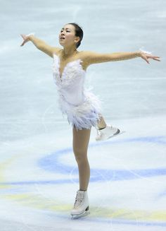 TOKYO, JAPAN - APRIL 13:  Mao Asada of Japan competes in the ladies's free skating during day three of the ISU World Team Trophy at Yoyogi National Gymnasium on April 13, 2013 in Tokyo, Japan.