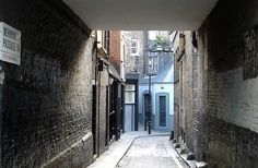 Newman Passage in Westminster, London, was the inspiration for Cinder Street where Natalie lives with Day's family. Cinder, Westminster, Family Photo, Photo Credit, Phoenix, London, Street, City, Creative