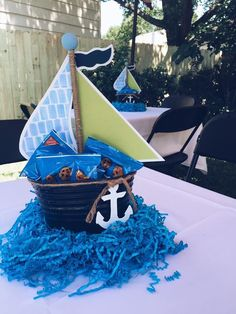 02 a nautical centerpiece of a bucket with crackers and an anchor - Shelterness Sailor Baby Showers, Anchor Baby Showers, Nautical Theme Baby Shower, Nautical Baby Shower Decorations, Fiesta Baby Shower, Baby Boy Shower, Baby Shower Gifts, Baby Party, Baby Shower Parties