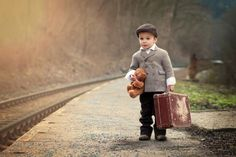 Young man gets all dressed up to runaway with his best friend and suitcase