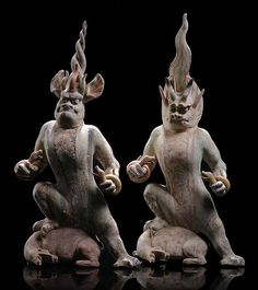 A FINE PAIR OF PAINTED GREY POTTERY EARTH SPIRITS, China, Tang dynasty.