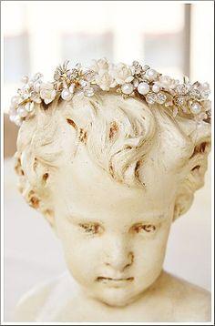 Tiara adorned cherub