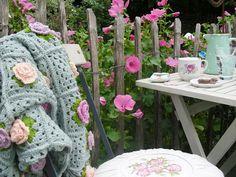 Crochet throw amongst the garden