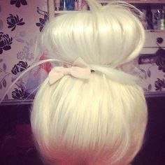 big blonde bun with a little bow
