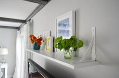Young House Love | A Cheap and Easy Shelf For That Blank Spot Over The TV | http://www.younghouselove.com