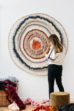 """Tammy Kanat creates textile art that's larger than life. Her colorful, highly-textural wall hangings feature organic circular and oval shapes that are a celebration of materials. """"For me,"""" she says, """"weaving projects a mood. Weaving Projects, Weaving Art, Loom Weaving, Tapestry Weaving, Fabric Weaving, Rug Loom, Weaving Patterns, Art Projects, Knitting Patterns"""