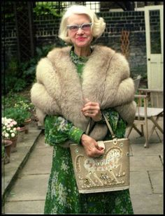 Maureen, Marchioness of Dufferin & Ava nee Guiness (1907– 1998) carrying an Enid Collins bucket bag circa 1973.
