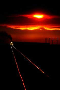 Scenic view of an approaching train near sunset ~~ nice pic...
