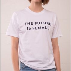 """Otherwild The Future Is Female t-shirt XS / SMALL This is a white T-Shirt in the cult favorite """"The Future Is Female"""" slogan created by Otherwild, the Los Angeles boutique that discovered a vintage photo of this women's liberation slogan on Instagram and recreated it. This is the real deal. Shirt is basically an XS / Small. It's an American Apparel size 12 youth, so the measurements are: 17.5 inches from armpit to armpit across chest, 13.5 inches from shoulder seam to shoulder seam, 5 inch…"""