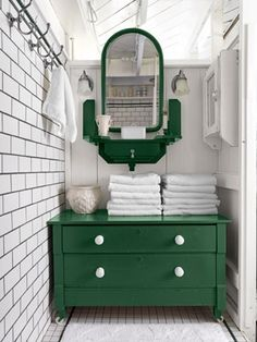 Emerald Green Vanity - GREAT design for a small space; Pop a single bright color for a Bold Statement, keep a tight color scheme for continuity, allow the tile to create pattern by using a dark grout color (easy for cleaning and big impact = smart)
