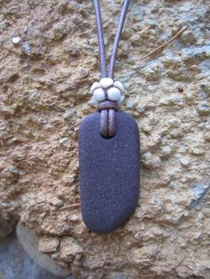 Natural beach stone pendant with unique carved by HealingBones, $25.00