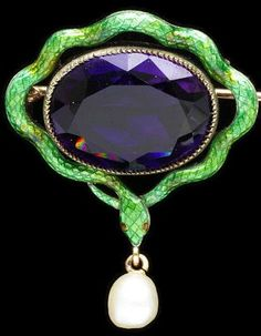 Child & Child suffragette brooch ca. 1900 via The Victoria & Albert Museum. The colors green white and violet were code for Give Women the Vote.