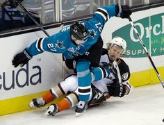 San Jose Sharks forward Joonas Donskoi collies with Hampus Lindholm of the Anaheim Ducks (Oct. 10, 2015).