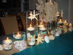 Rent Beach Themed Floating Candle Centerpieces $ 75.00 Basic Set of 5Cylinder vases with LED & floating candles $ 20.00-30.00 Upgrade add Seashells or Sea inside glass  $ 65.00 Upgrade Add Large shells, starfish, sand dollars, barnacles and additional cylinders with floating candles.  Call or email for a free price quote  (631) 421-2286 www.sweet16candelabras.com We have over 90 videos on our YouTube channel www.youtube.com/sweet16candelabras