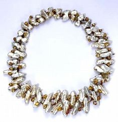 ANDREW GRIMA PEARL AND TOPAZ NECKLACE Andrew Grima was one of the most important and influential 20th century jewelry designers. This unique necklace is in complexly worked 18k gold, with interesting, oddly shaped pearls, and accented by topaz. C1970's.   Andrew Grima, while English, had a wide following in the US. Grima's jewelry is highly valued for its originality, stylishness and fine workmanship, and his vintage pieces are becoming increasing difficult to find. (hva)